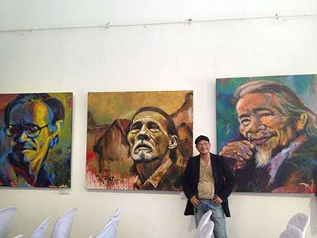 Artist Tran Dat, paints portraits, calligraphy works, sketches