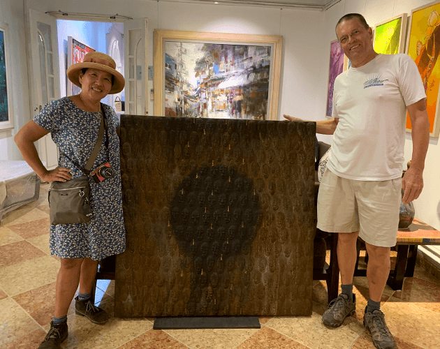 Happy customers with the famous Vietnamese paintings
