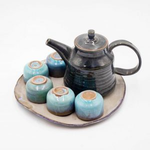 art ceramic tea pot and cups with blue enamel